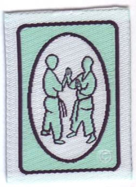 pushing hands badge